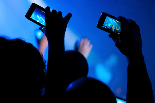 168723557-concert-video-recording-with-cell-phone